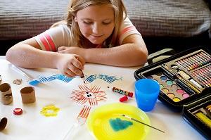Kid drawing, creating